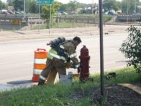 Firefighter hooking up to a hydrant