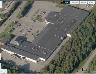 (6) An aerial photograph of a building housing several companies. The second building from the left was hit by a very large fire. (Photos courtesy of <a href=