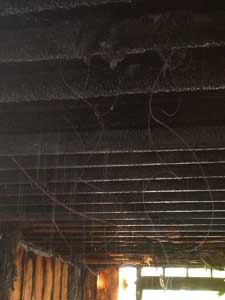 (16) Wires from a flex duct that have burned away, creating a significant entrapment threat to firefighters.