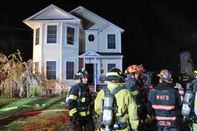 (6) This house is the Bravo exposure and is a mirror image of the fire building. Note the large soffits on the attic over the windows. (Photo by Tom Bierds.)