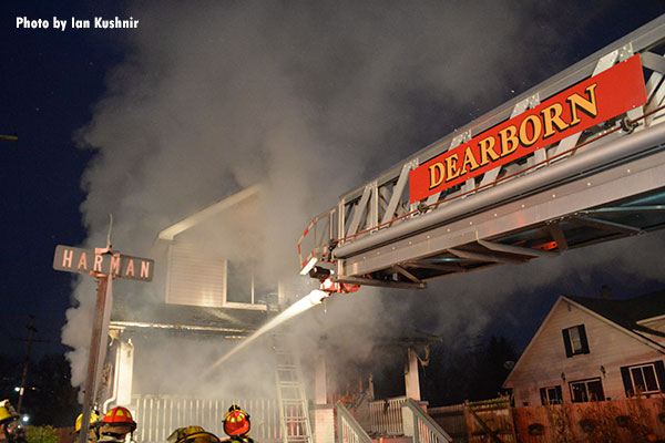 Flowing water from a Dearborn apparatus in the burning home.