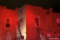 Multiple ladders thrown at apartment fire