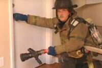 Ray McCormack at the door with a nozzle and hoseline