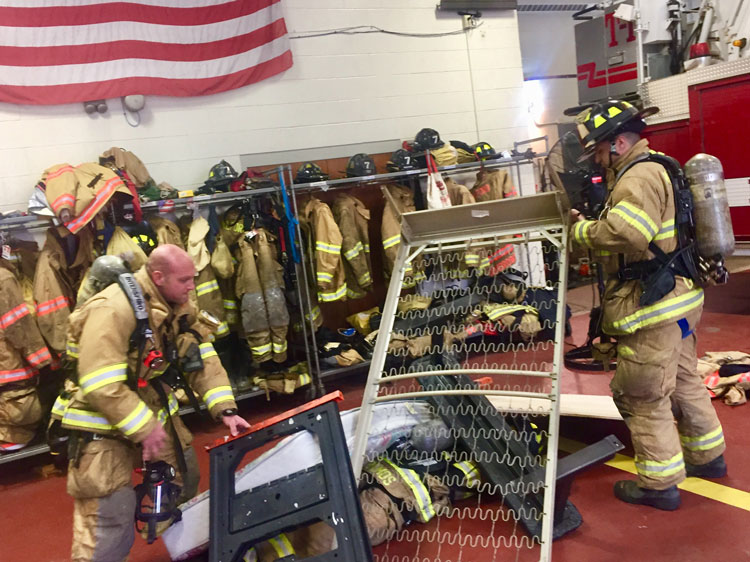 Members create some pressure on the down firefighter