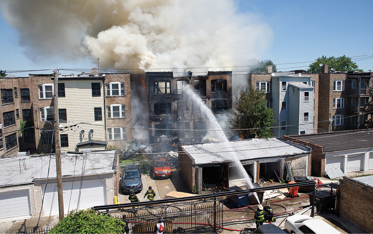 (5) The chief assigned to the rear withdrew members for the back out of the collapse zone. Handlines are now operated from beyond the collapse zone from a flanking position.