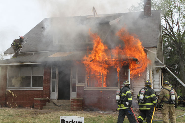 Firefighters conduct a training fire at an acquired structure