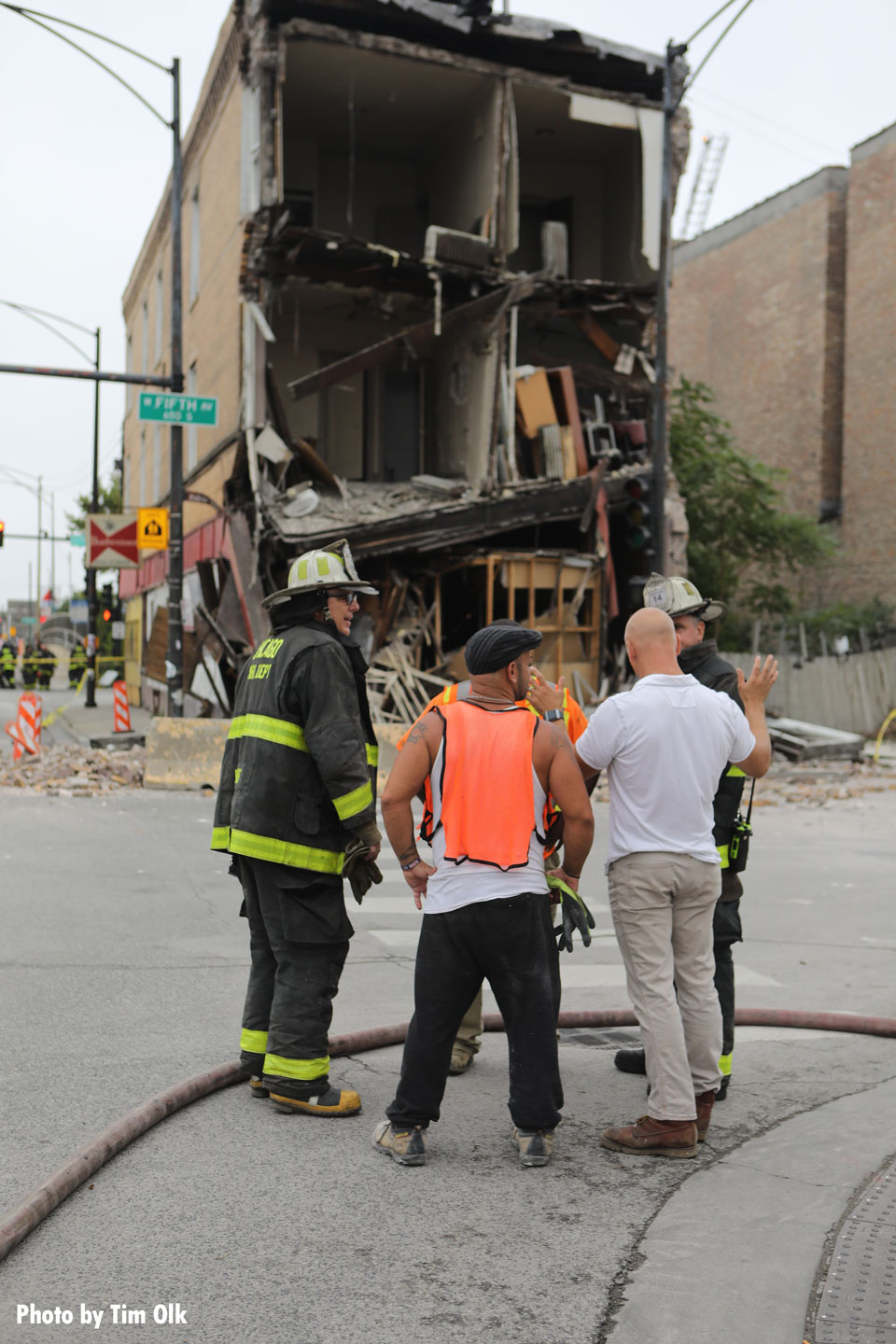Chicago Fire Department members and others at the scene of the collapse.