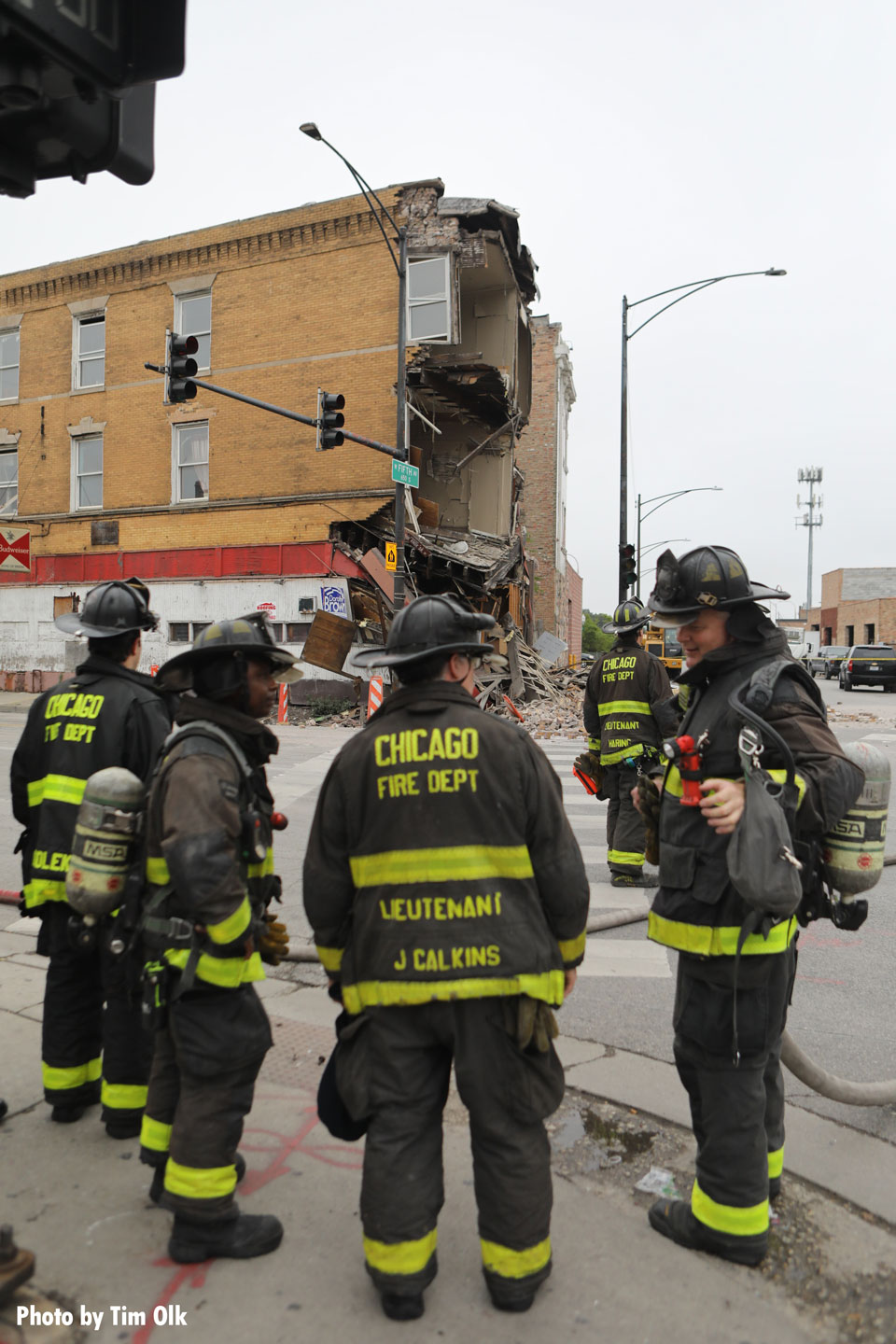 Members of the Chicago Fire Department confer about the incident.