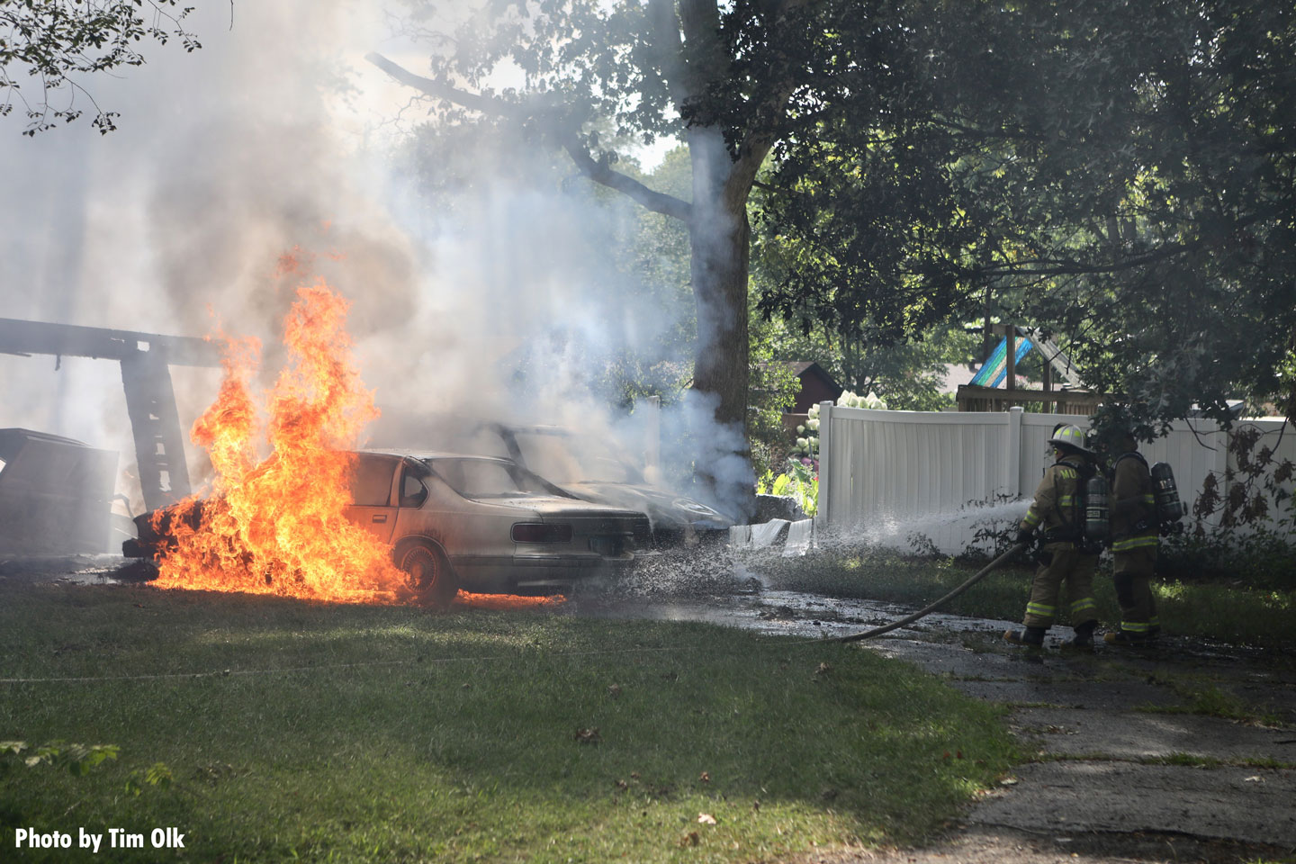The fire spread to multiple vehicles and a fence.