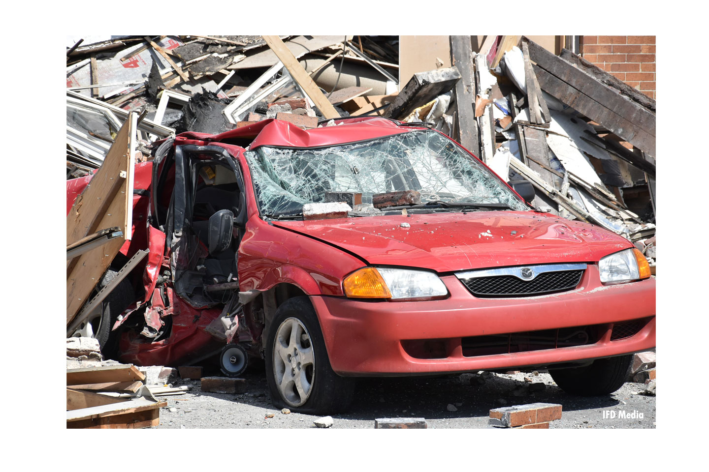 A vehicle in the debris.