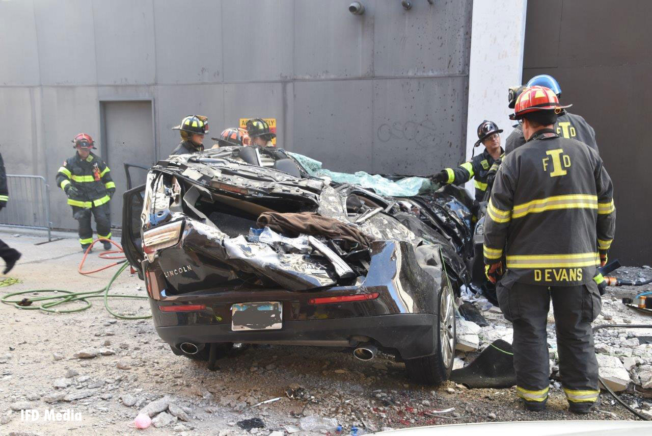 Indianapolis firefighters responded to a fatal incident in which a car fell from a parking garage.