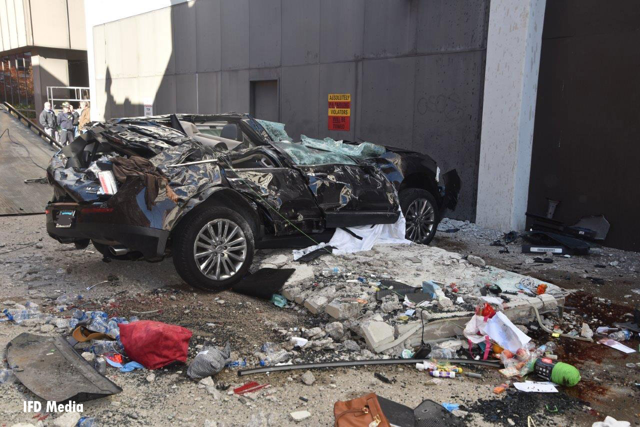 Two victims were killed when the car plunged from the fourth floor of the parking garage.