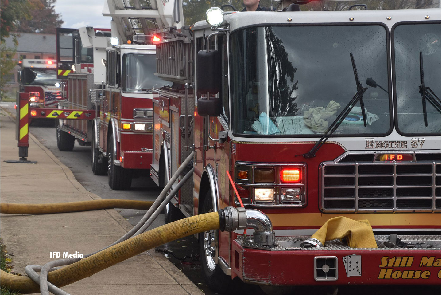 Rigs lined up at the fire scene.