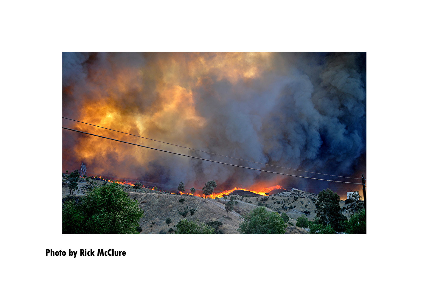 A line of flames along the side of a hilll