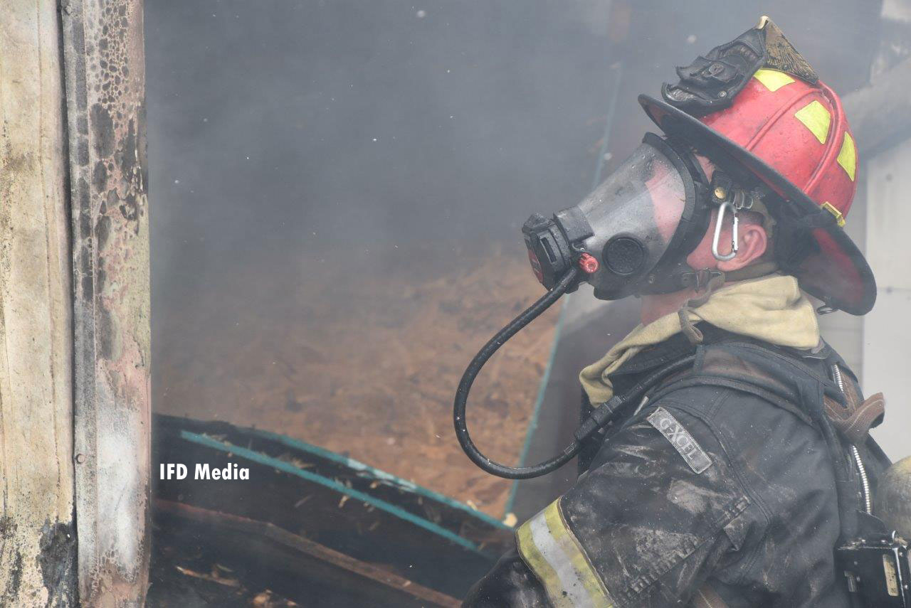 A firefighter in SCBA working at the fire scene