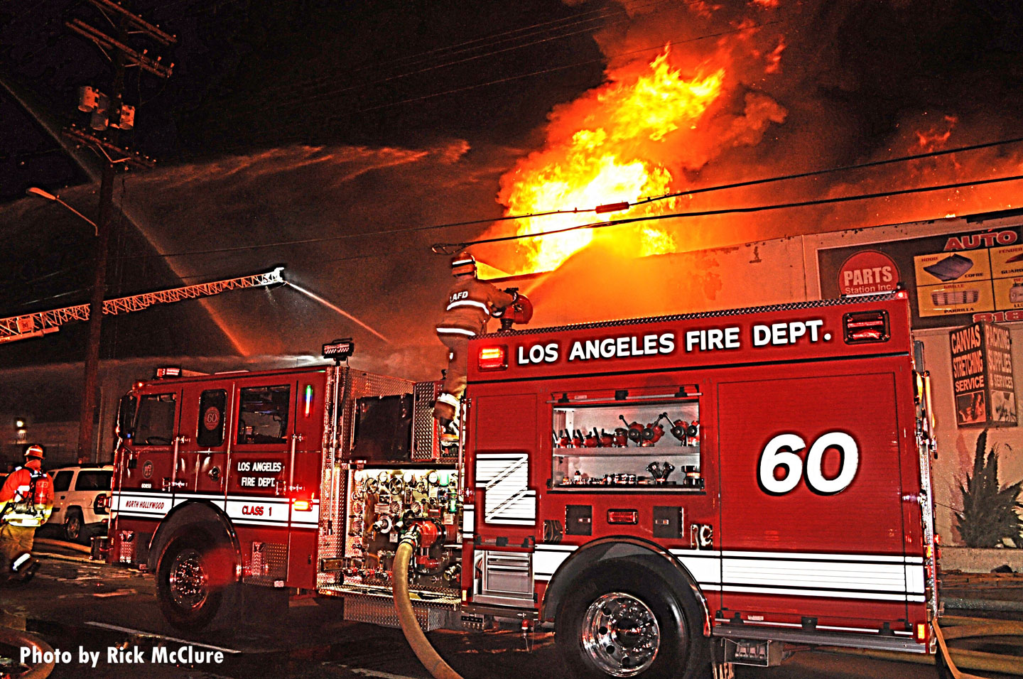 LAFD pumper with deck gun and streams in the distance