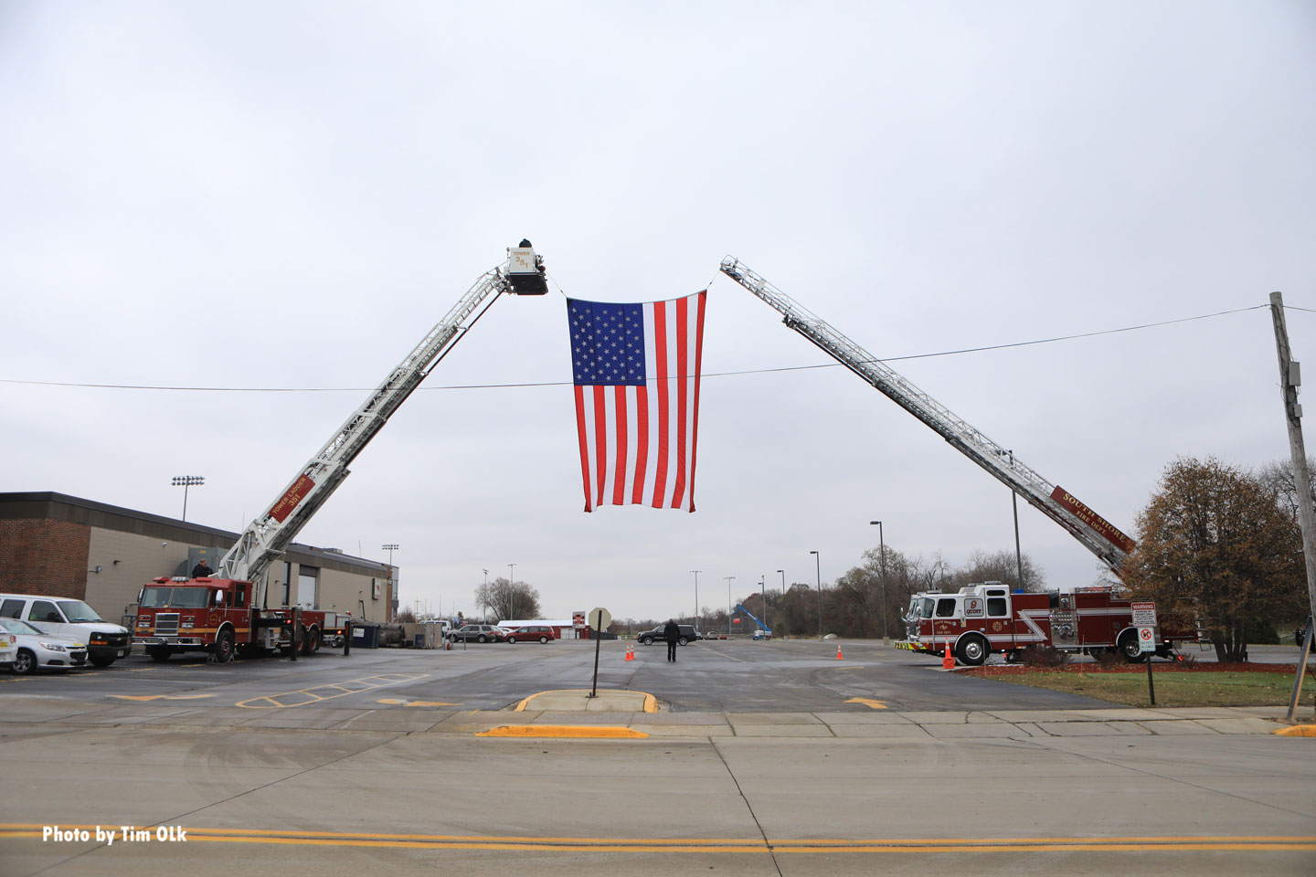 Massive American flag between two aerial devices