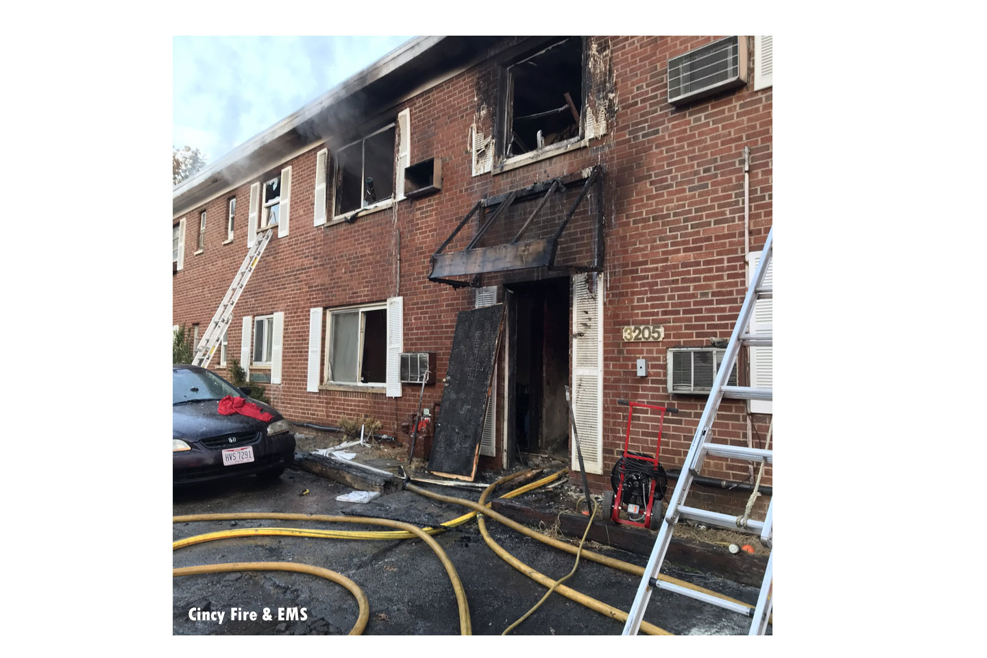 Photo shows laddering and line placement at the fire as well as damage to the building.