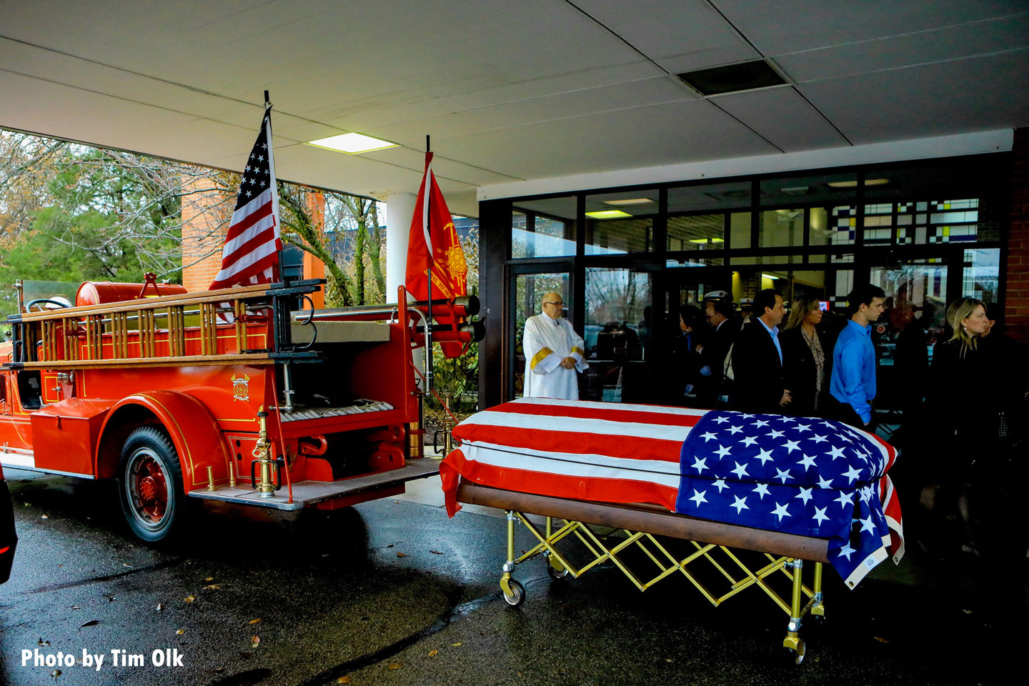 The casket containing the chief's remains to be loaded onto the rig.