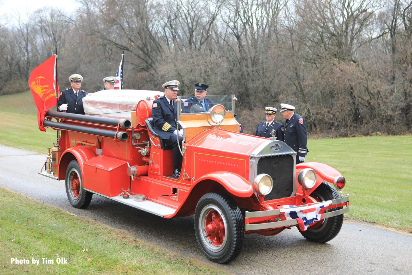 An old fire apparatus bearing the casket.