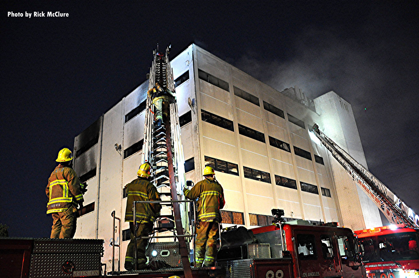 Firefighters on scene at the fire in a vacant building in Los Angeles.