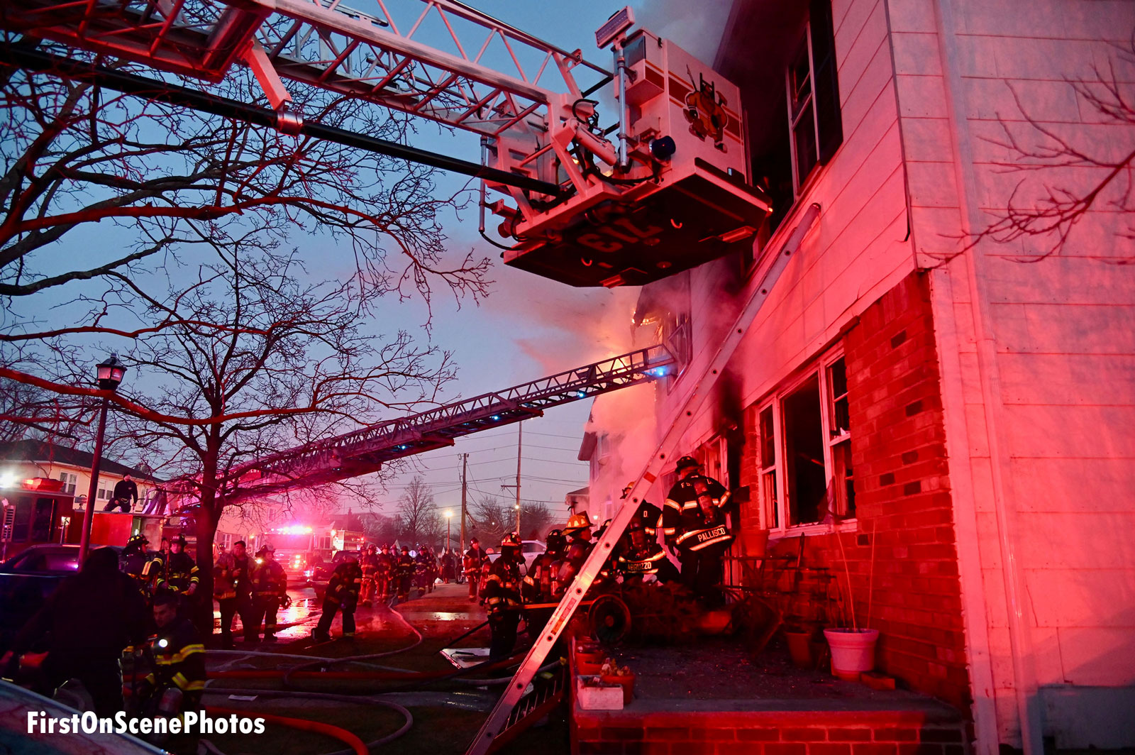 A view of various ladders and apparatus at the fire scene