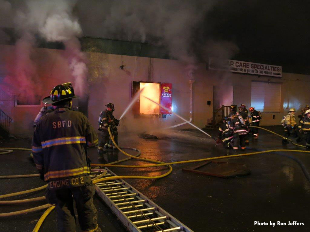 Firefighters at the scene of a fire in a commercial building in Lodi, New Jersey.