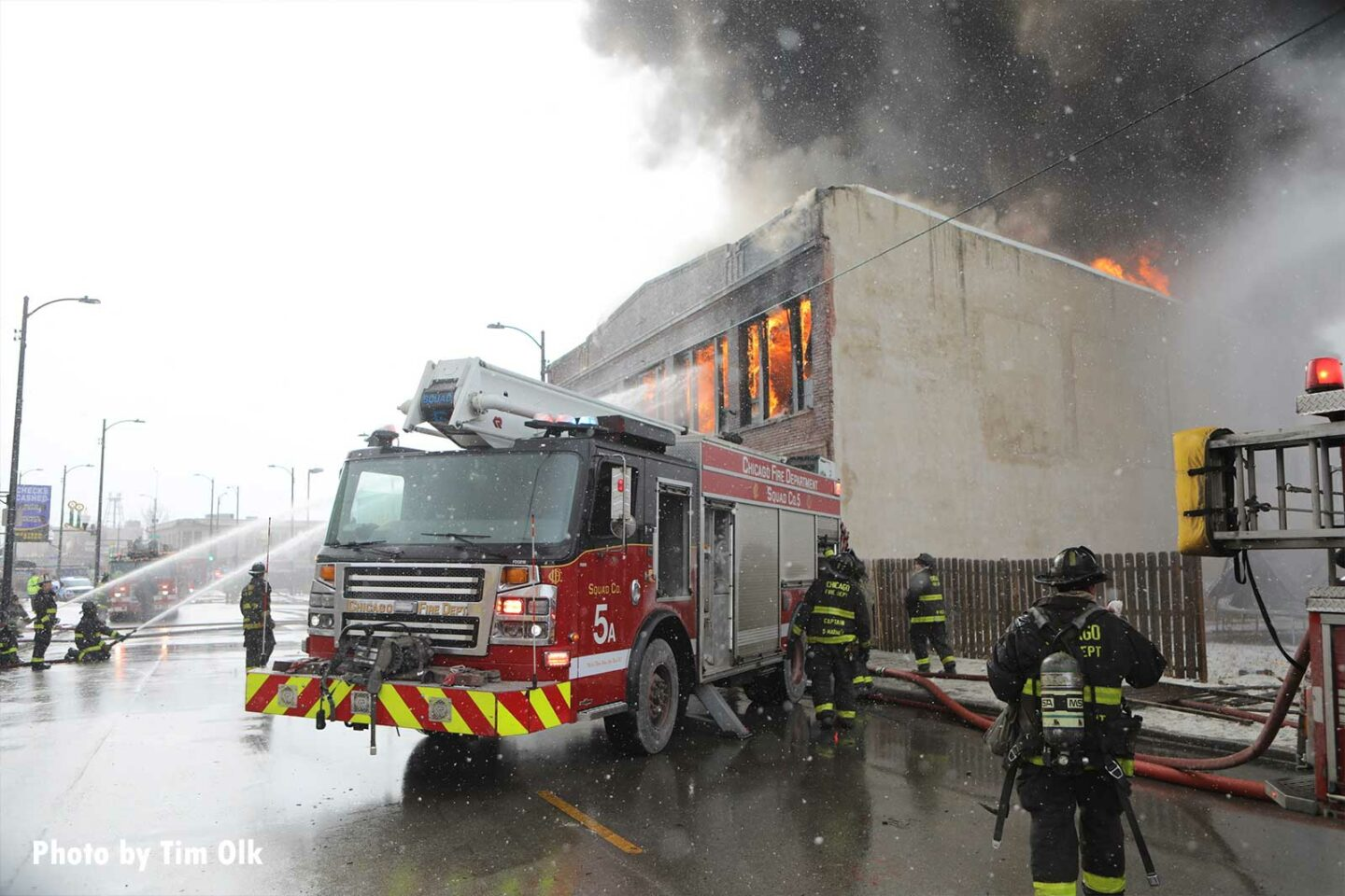 Chicago firefighters and fire truck with burning building
