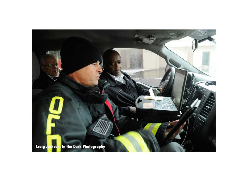 Command staff review strategy and tactics inside a fire department vehicle