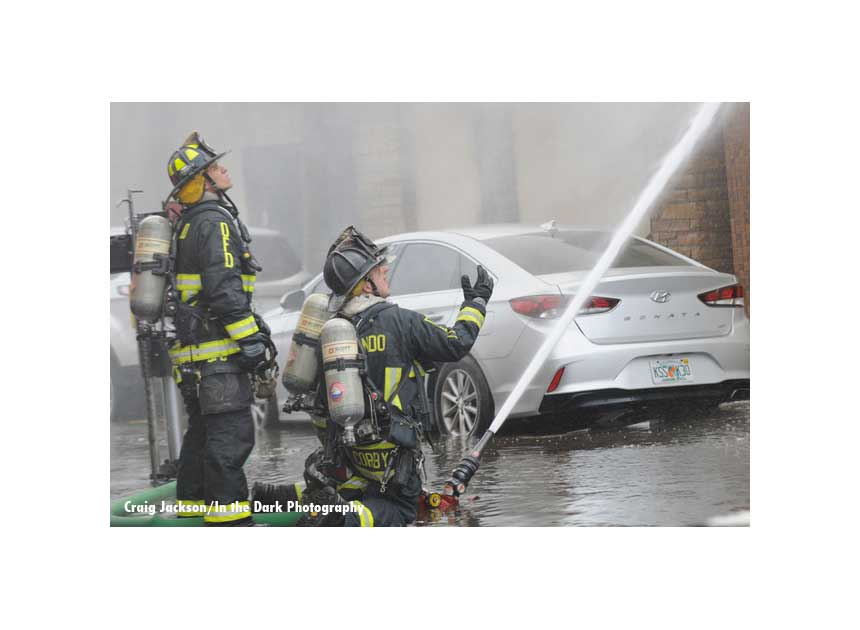 Another view of hose streams directed a fire building