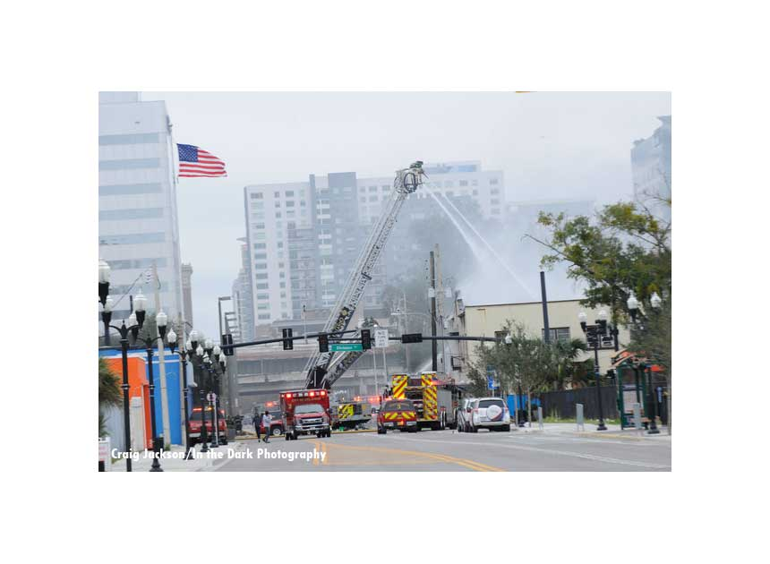 View of building and tower ladders working at the scene