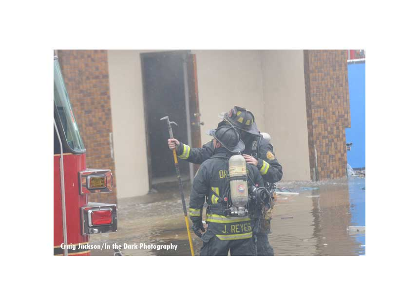Firefighters confer on the fire scene in Orlando