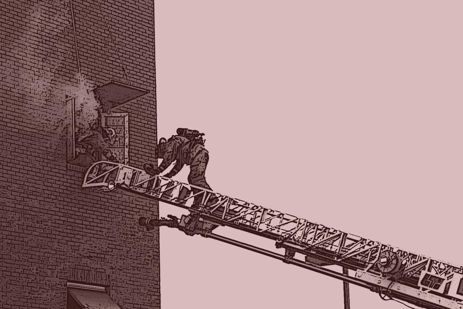Firefighters climbing an aerial ladder