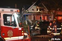 Indianapolis fire truck and firefighters at the scene of a structure fire