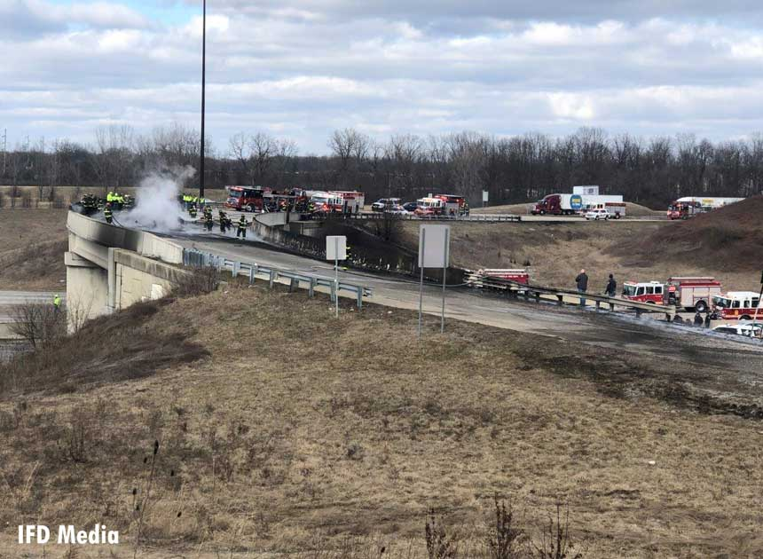 Fire trucks and firefighters at the scene of the tanker truck fire