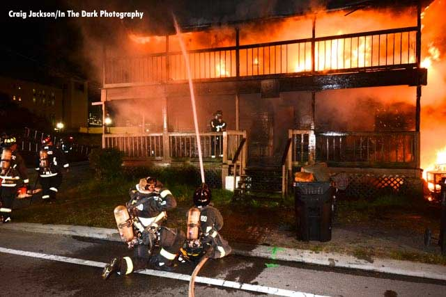 Firefighters confront a raging house fire in Orlando, Florida