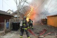Chicago firefighters flake out a hoseline on the fireground