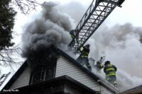 Firefighters perform roof ventilation at a Chicago fire