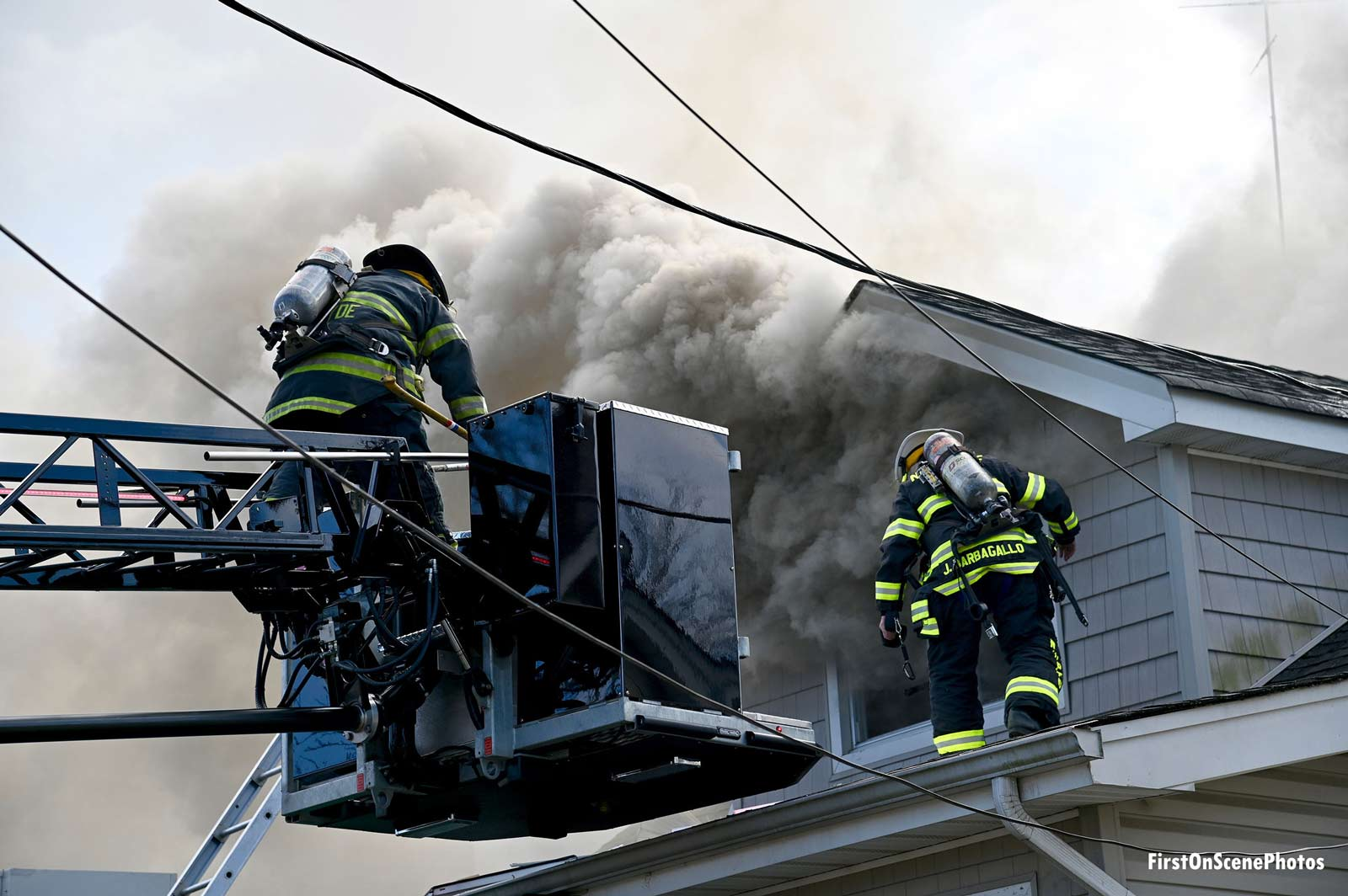 Firefighters in a bucket at a Long Island house fire