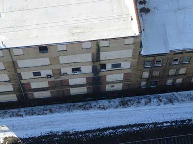 Birds-eye view of a building captured using a drone