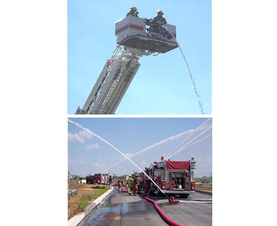 Firefighters in a bucket and fire apparatus