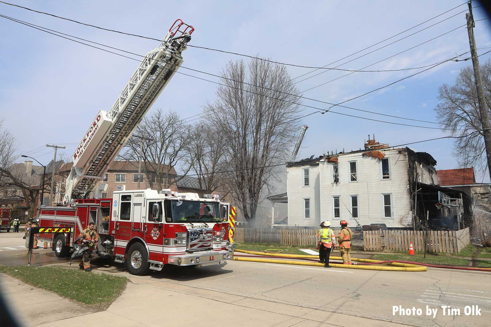 Fire truck with aerial ladder on the fireground