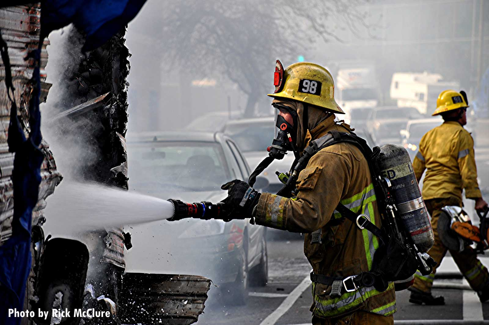LAFD member with a hoseline