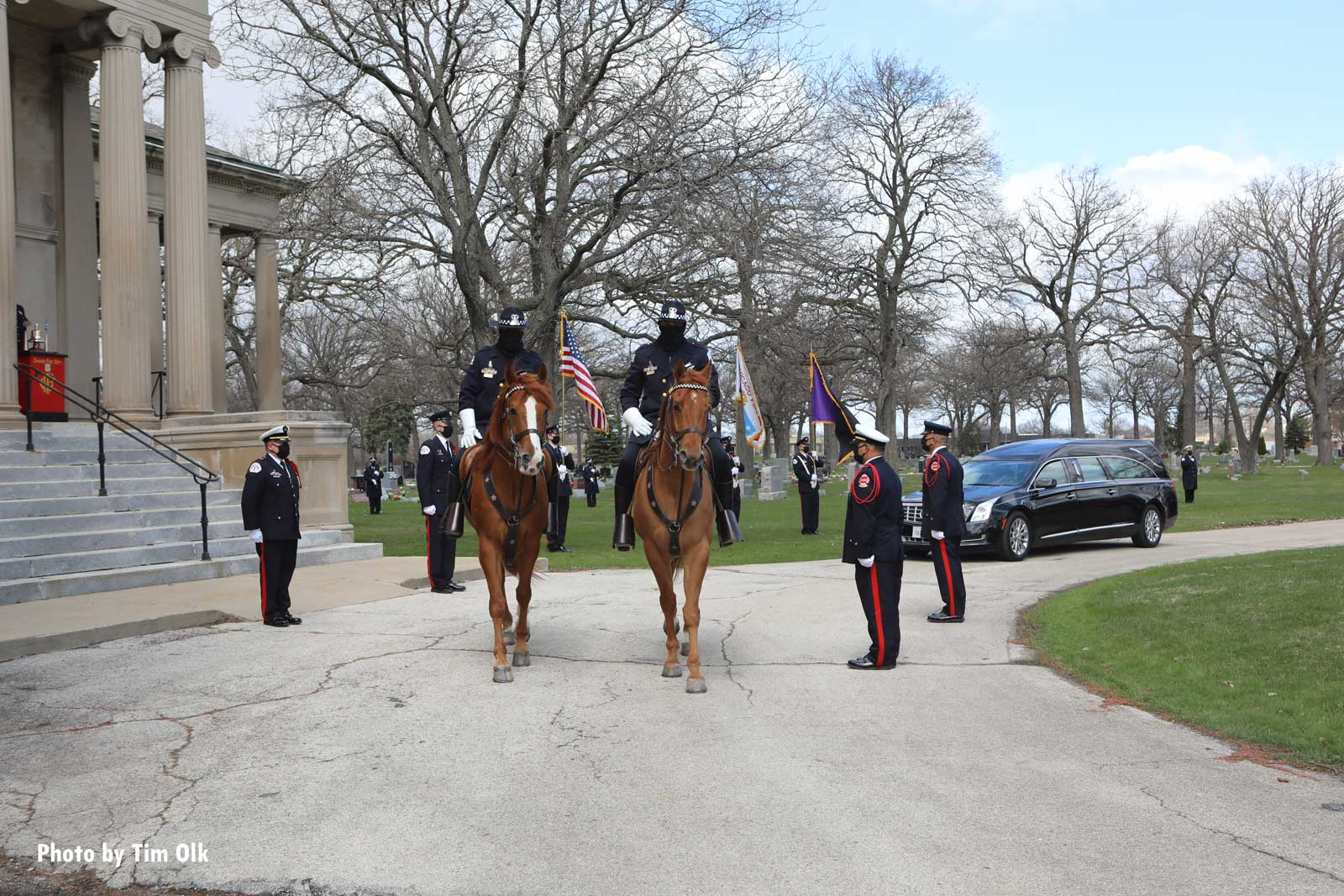 Firefighters mounted on horses at the funeral
