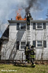 Firefighters perform vertical ventilation at a fire in Fitchburg, Massachusetts