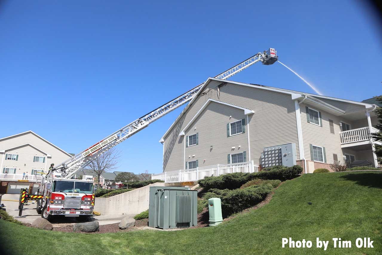 An aerial device in operation at an apartment fire