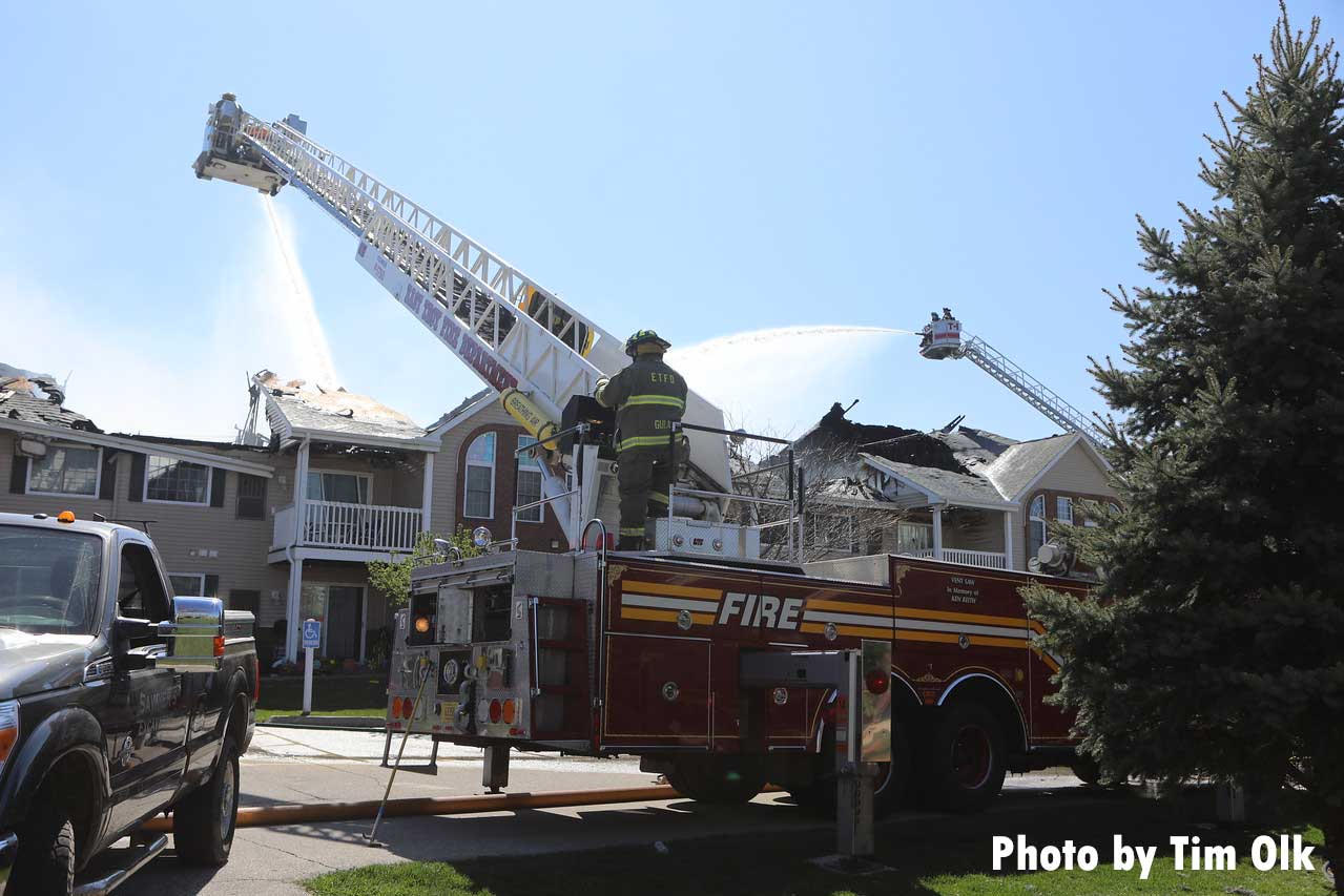 More images of tower ladders working at the apartment fire