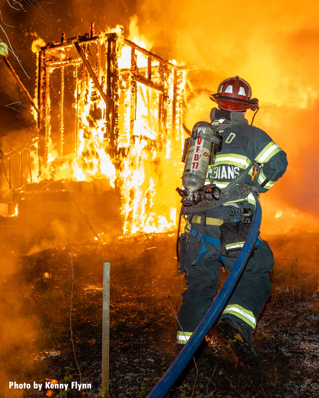 Columbian Engine Co. firefighter John Conjura advances a second hoseline to help extinguish the flames.