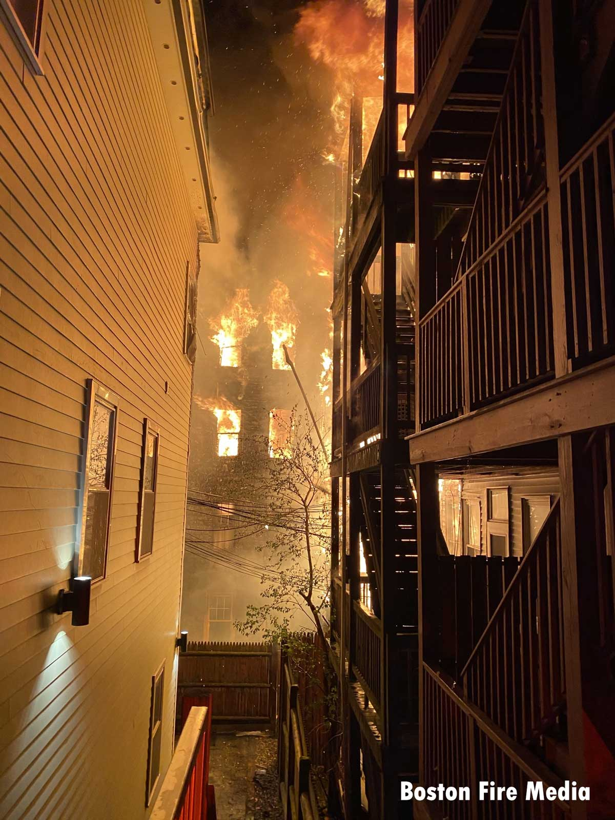 A view of the flames between buildings