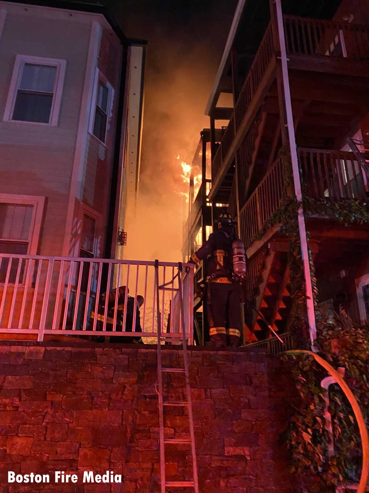 Firefighters working at a seven-alarm fire in South Boston